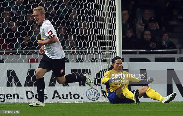 Mike Hanke of Moenchengladbach celebrates after he scores his team's 2nd goal during the Bundesliga match between SV Werder Bremen and Borussia...