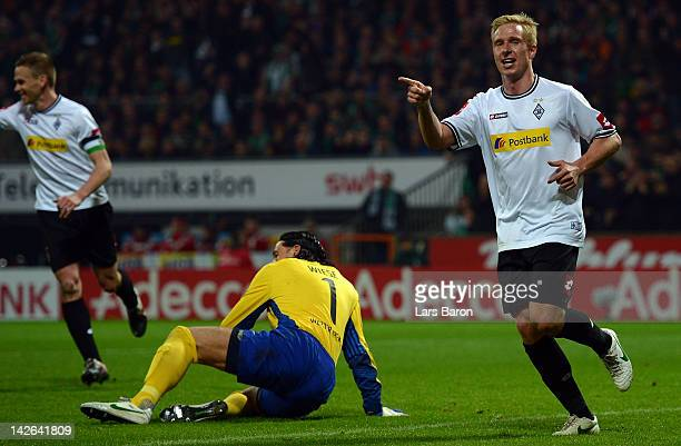 Mike Hanke of Moenchengladbach celebrates after scoring his teams second goal during the Bundesliga match between SV Werder Bremen and Borussia...