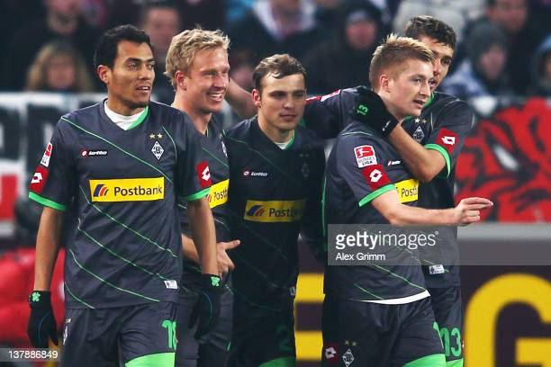 Mike Hanke of Moenchengladbach celebrates his team's first goal with team mates Juan Arango Tony Jantschke Marco Reus and Roman Neustaedter during...