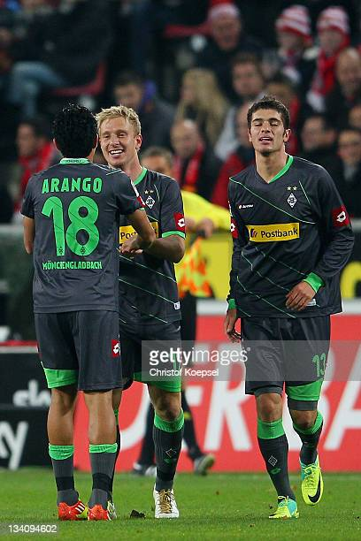 Mike Hanke of Moenchengladbach celebrates the first goal with Juan Arrango and Roman Neustaedter during the Bundesliga match between 1 FC Koeln and...
