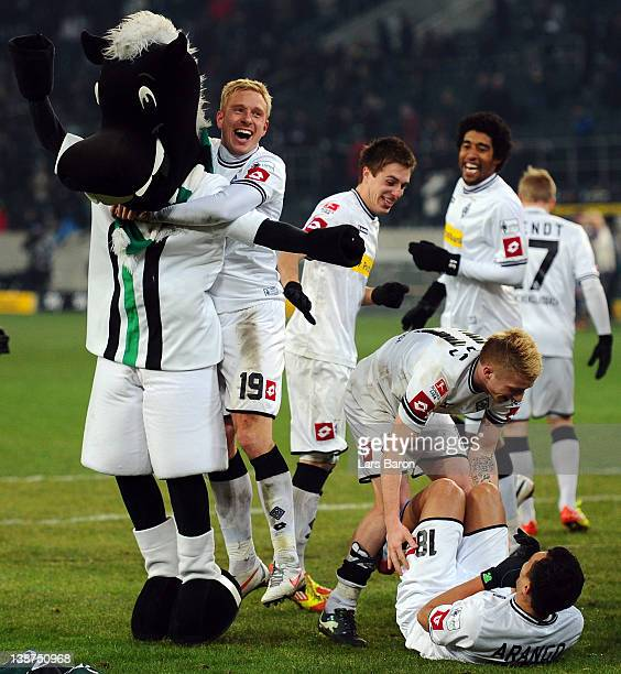 Mike Hanke of Moenchengladbach celebrates with mascot Juenter next to Marco Reus and Juan Arango after winning the Bundesliga match between Borussia...