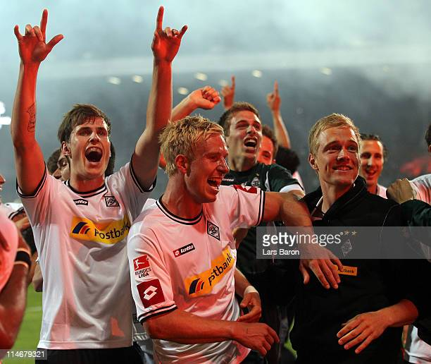 Mike Hanke of Moenchengladbach celebrates with team mates after the Bundesliga play off second leg match between VfL Bochum and Borussia...