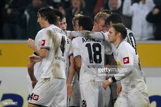 Mike Hanke of Moenchengladbach celebrates with teammates after scoring his team's opening goal during the Bundesliga match between Borussia...