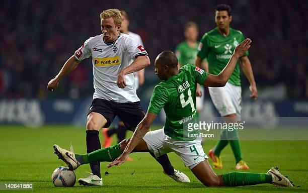 Mike Hanke of Moenchengladbach is challenged by Naldo of Bremen during the Bundesliga match between SV Werder Bremen and Borussia Moenchengladbach at...