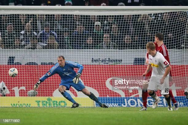 Mike Hanke of Moenchengladbach scores the first goal Jaroslav Dorbny of Hamburg during the Bundesliga match between Borussia Moenchengladbach and...