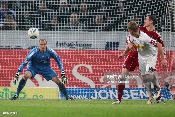 Mike Hanke of Moenchengladbach scores the first goal Jaroslav Dorbny of Hamburg and Marcell Jansen during the Bundesliga match between Borussia...