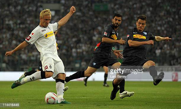 Mike Hanke of Moenchengladbach shoots on goal next to Marcel Maltritz of Bochum during the Bundesliga play off first leg match between Borussia...