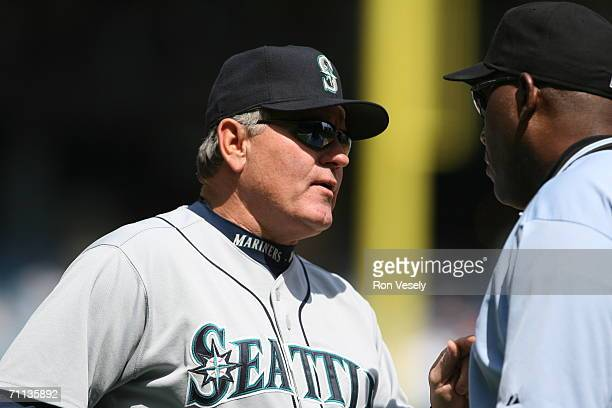Mike Hargrove of the Seattle Mariners speaks with umpire Chuck Meriwether during the game against the Chicago White Sox at US Cellular Field in...