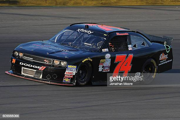 Mike Harmon driver of the Dodge on track during practice for the NASCAR XFINITY Series VysitMyrtleBeachcom 300 at Kentucky Speedway on September 23...