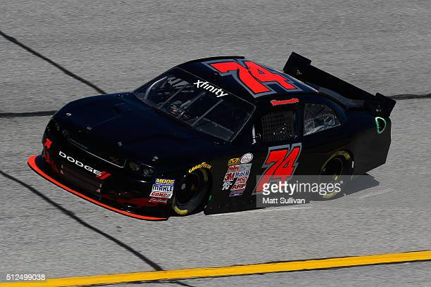 Mike Harmon driver of the Dodge practices for the NASCAR XFINITY Series Heads Up Georgia 250 at Atlanta Motor Speedway on February 26 2016 in Hampton...