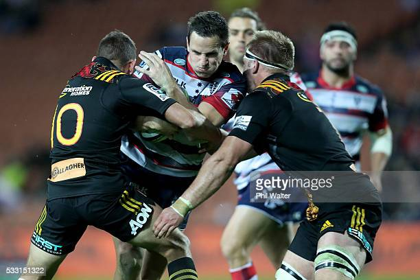 Mike Harris of the Rebels is tackled during the round 13 Super Rugby match between the Chiefs and the Rebels at FMG Stadium on May 21 2016 in...