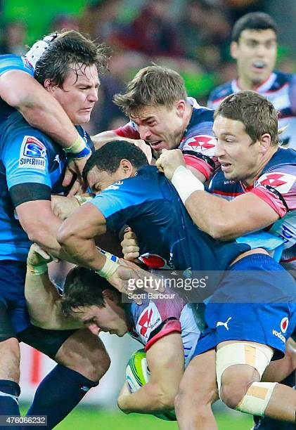 Mike Harris of the Rebels is tackled during the round 17 Super Rugby match between the Rebels and the Bulls at AAMI Park on June 6 2015 in Melbourne...