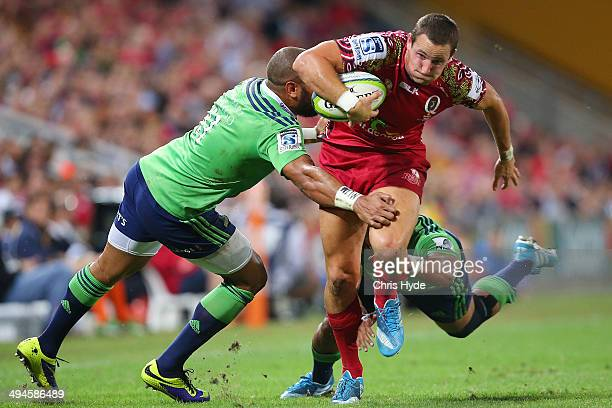 Mike Harris of the Reds makes a break during the round 16 Super Rugby match between the Reds and the Highlanders at Suncorp Stadium on May 30 2014 in...