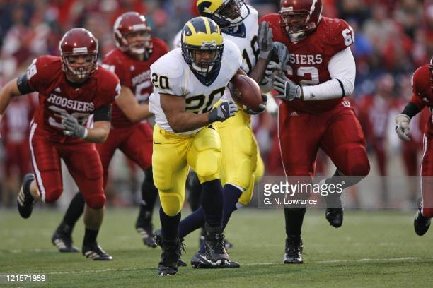 Mike Hart leaves tacklers in pursuit as he runs for yardage during action between the Michigan Wolverines and Indiana Hoosiers at Memorial Stadium in...