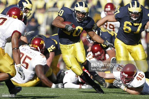 Mike Hart of Michigan rushes during the second half against Minnesota on October 8 2005 at Michigan Stadium in Ann Arbor Michigan Minnesota kicked a...