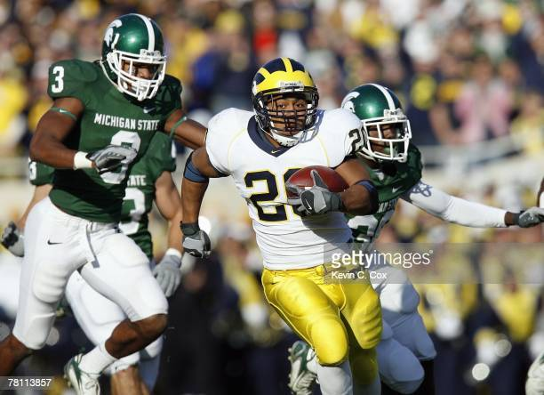 Mike Hart of the Michigan Wolverines carries the ball during the game against the Michigan State Spartans at Spartan Stadium November 3 2007 in East...
