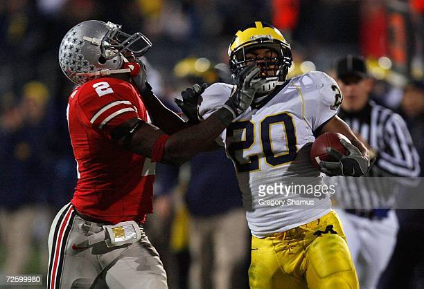 Mike Hart of the Michigan Wolverines stiff arms Malcolm Jenkins of the Ohio State Buckeyes in the third quarter November 18, 2006 at Ohio Stadium in...