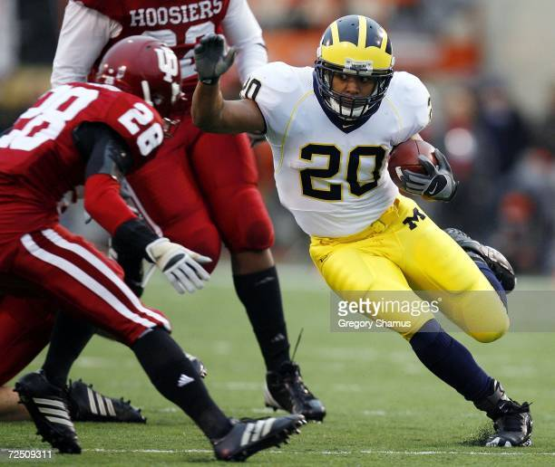 Mike Hart of the Michigan Wolverines tries to get around the tackle of Leslie Majors of the Indiana Hoosiers during first quarter action on November...