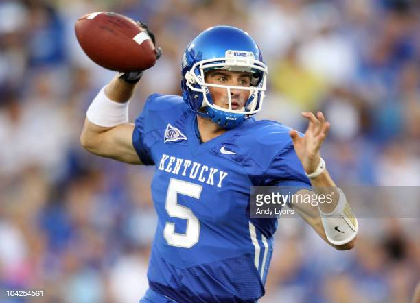 Mike Hartline of the Kentucky Wildcats throws a pass during the game against the Akron Zips at Commonwealth Stadium on September 18 2010 in Lexington...