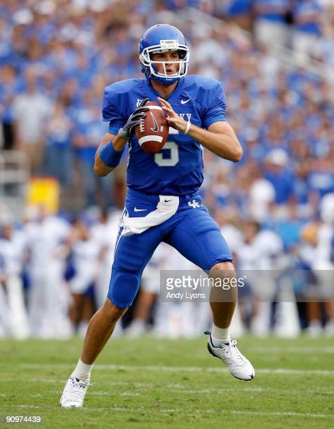 Mike Hartline of the Kentucky Wildcats throws a pass during the game against the Louisville Cardinals at Commonwealth Stadium on September 19 2009 in...