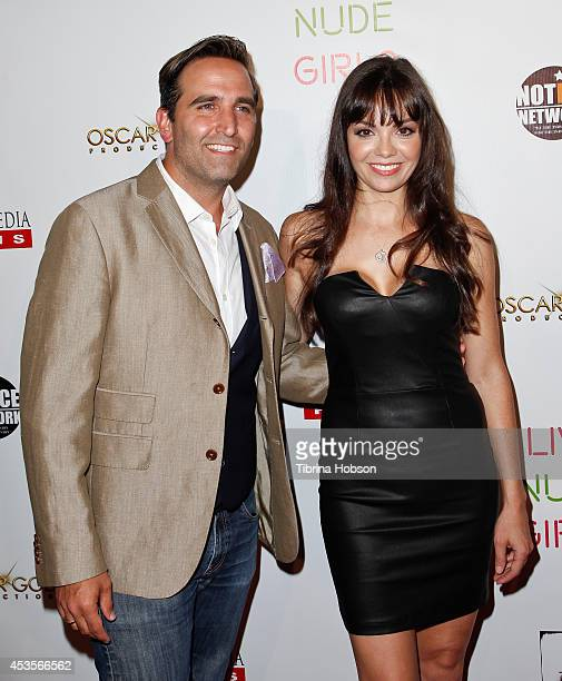 Mike Hatton and Annemarie Pazmino attend the 'Live Nude Girls' premiere at Avalon on August 12 2014 in Hollywood California