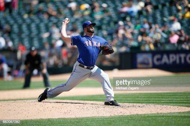 Mike Hauschild of the Texas Rangers pitches during the game against the Oakland Athletics at the Oakland Alameda Coliseum on April 19 2017 in Oakland...