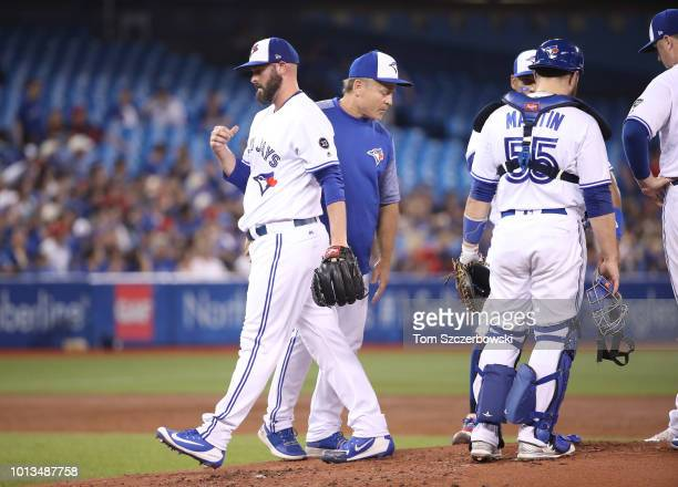 Mike Hauschild of the Toronto Blue Jays is taken out of the game by manager John Gibbons in the third inning during MLB game action against the...