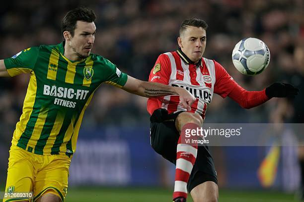 Mike Havenaar of ADO Den Haag Santiago Arias of PSV during the Dutch Eredivisie match between PSV Eindhoven and ADO Den Haag at the Phillips stadium...