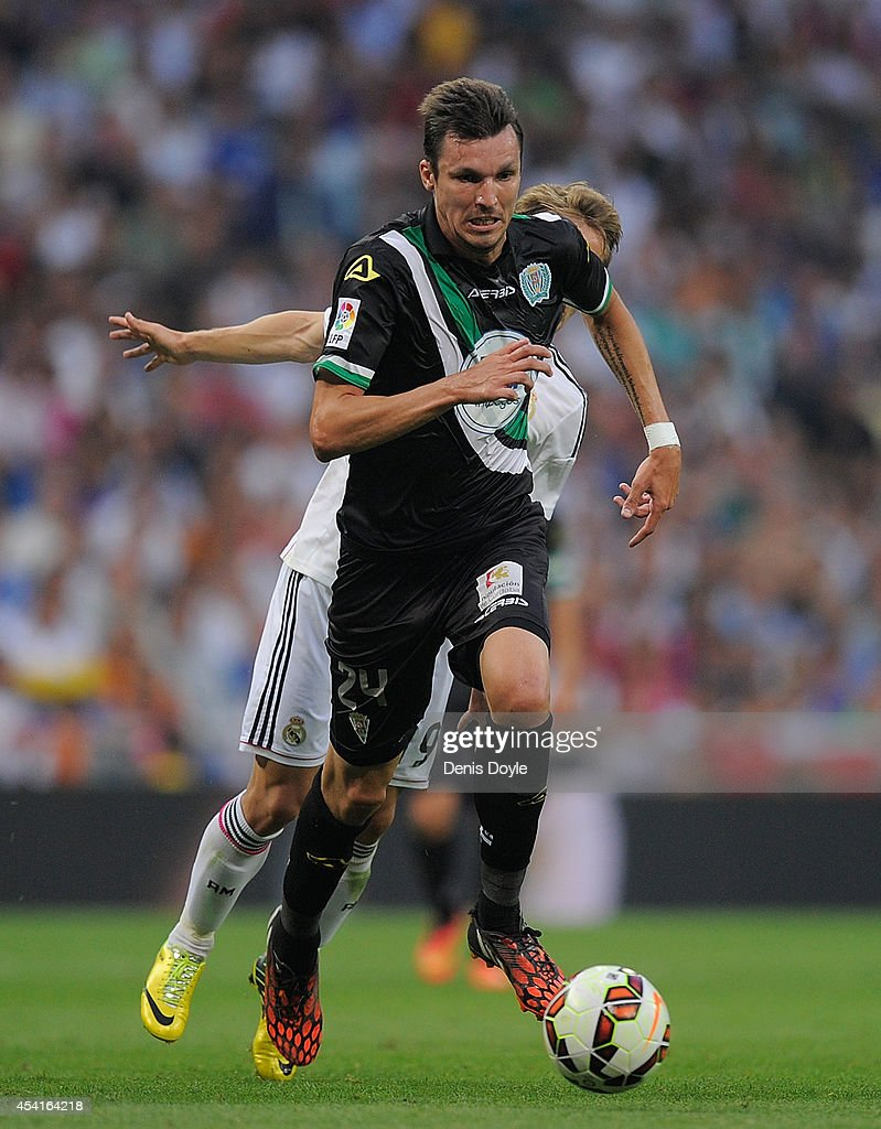 Mike Havenaar of Crodoba CF outpaces Luka Modric of Real Madrid during the La liga match between Real Madrid CF and Cordoba CF at Estadio Santiago Bernabeu on August 25, 2014 in Madrid, Spain.