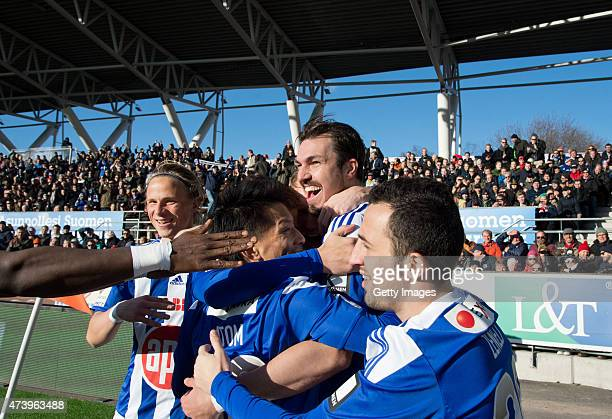 Mike Havenaar of HJK Helsinki celebrates scoring his team's first goal with his team mates during the Finnish First Division match between HJK...