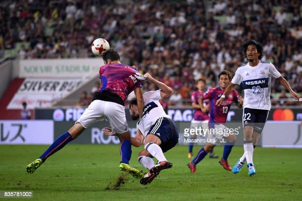 Mike Havenaar of Vissel Kobe is challenged by Milos Degenek of Yokohama FMarinos in the penalty area during the JLeague match between Vissel Kobe and...
