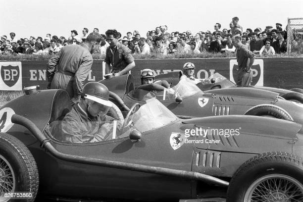 Mike Hawthorn Luigi Musso Harry Schell Ferrari Dino 246 Grand Prix of France Reims 06 July 1958 Mike Hawthorn checks his watch just before the start...
