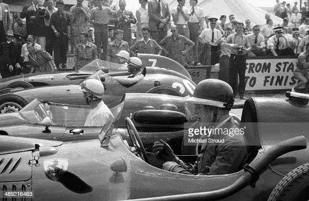 Mike Hawthorn of Great Britain sits aboard the Scuderia Ferrari Ferrari Dino 246 before the start of the British Grand Prix Silverstone July 19th 1958
