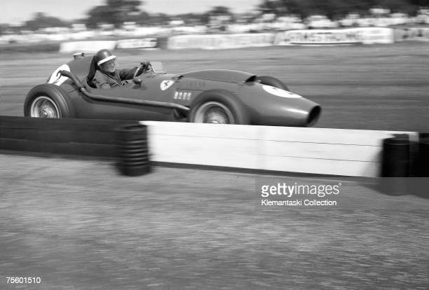 Mike Hawthorn speeds past one of Silverstones miniwalls in his Ferrari 246 during the British Grand Prix at Silverstone 19th July 1958 He finisehd...