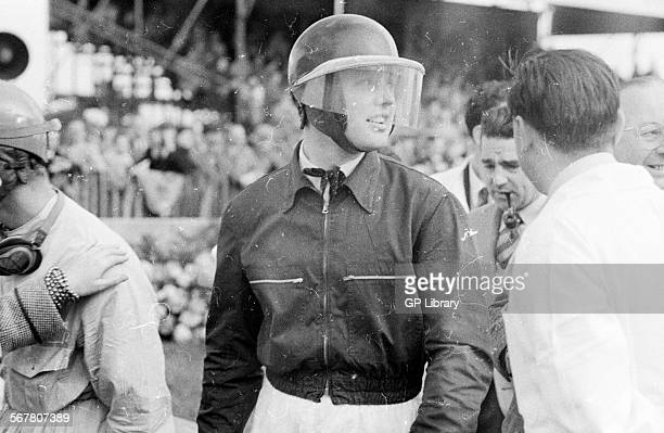 Mike Hawthorn with John Cooper in the background smoking pipe Goodwood International race meeting England 25 September 1954