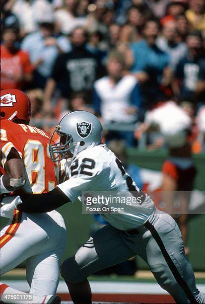 Mike Haynes of the Los Angeles Raiders tackles Stephone Paige of the Kansas City Chiefs during an NFL football game September 16 1984 at Arrowhead...
