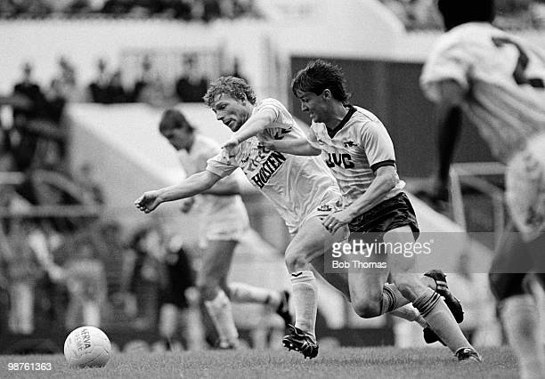 Mike Hazard of Tottenham Hotspur and Steve Williams of Arsenal challenge for the ball during the Glenn Hoddle Testimonial match held at White Hart...