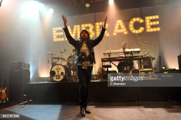Mike Heaton Danny McNamara and Mickey Dale of Embrace perform on stage at the O2 Shepherd's Bush Empire on April 6 2018 in London England