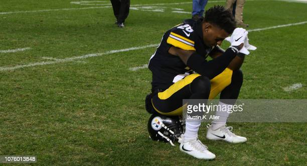 Mike Hilton of the Pittsburgh Steelers sits on the field after watching the Baltimore Ravens defeat the Cleveland Browns on the scoreboard at Heinz...