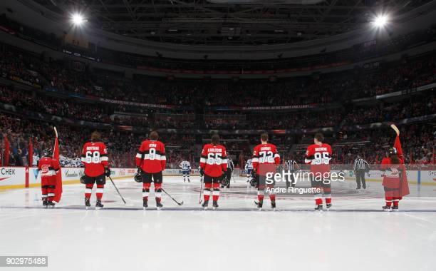 Mike Hoffman Bobby Ryan Erik Karlsson Thomas Chabot and Matt Duchene of the Ottawa Senators stand at attention during the singing of the national...