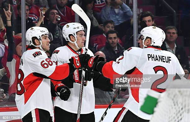 Mike Hoffman Dion Phaneuf and Mark Stone of the Ottawa Senators celebrate a goal against the Montreal Canadiens in the NHL game at the Bell Centre on...