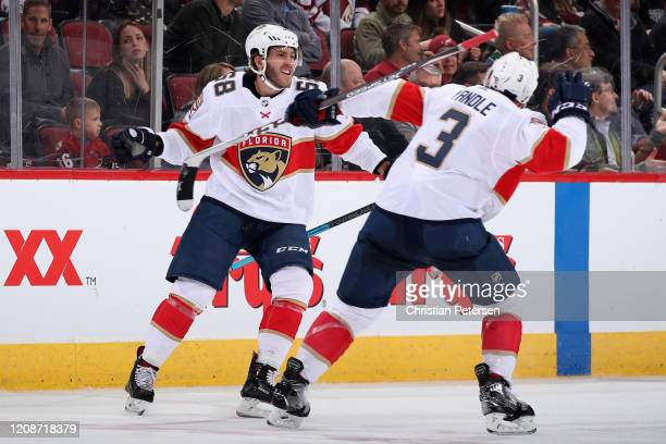 Mike Hoffman of the Florida Panthers celebrates with Keith Yandle after scoring a goal against the Arizona Coyotes during the third period of the NHL...