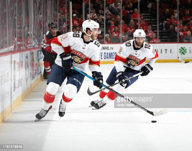 Mike Hoffman of the Florida Panthers plays the puck against the New Jersey Devils during the game on October 14 2019 at Prudential Center in Newark...