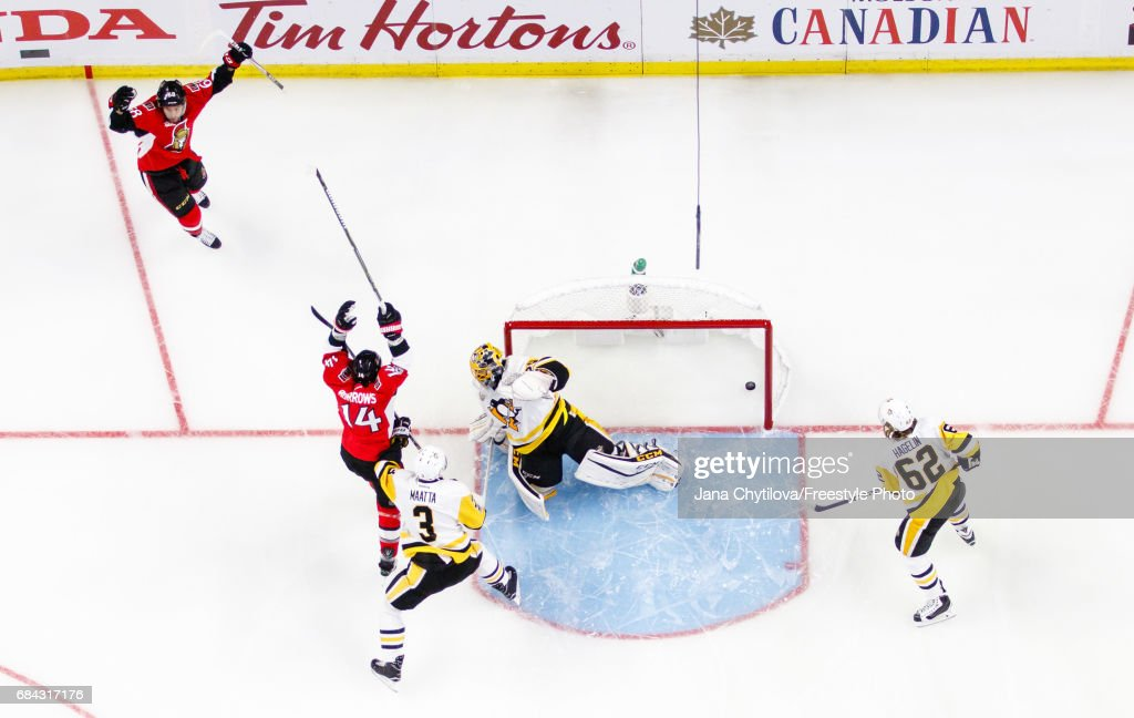 Mike Hoffman #68 of the Ottawa Senators celebrates his first period goal with teammate Alexandre Burrows #14 as Marc-Andre Fleury #29, Olli Maatta #3 and Carl Hagelin #62 of the Pittsburgh Penguins react in Game Three of the Eastern Conference Final during the 2017 NHL Stanley Cup Playoffs at Canadian Tire Centre on May 17, 2017 in Ottawa, Ontario, Canada.