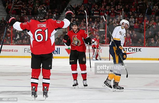 Mike Hoffman of the Ottawa Senators celebrates his third period goal with teammate Mark Stone as Austin Watson of the Nashville Predators reacts at...