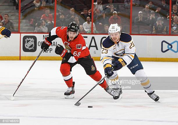 Mike Hoffman of the Ottawa Senators chases Sam Reinhart of the Buffalo Sabres as he skates on a breakaway in overtime at Canadian Tire Centre on...