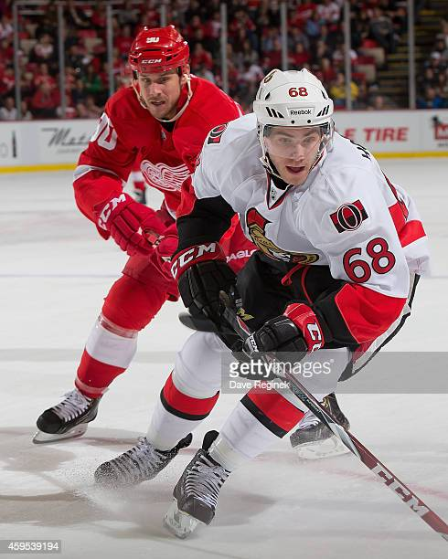 Mike Hoffman of the Ottawa Senators follows the play against the in front of Stephen Weiss of the Detroit Red Wings during a NHL game on November 24...