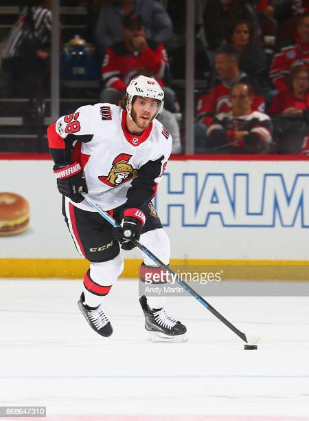 Mike Hoffman of the Ottawa Senators plays the puck during the game against the New Jersey Devils at Prudential Center on October 27 2017 in Newark...