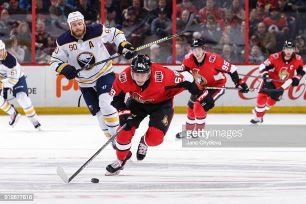 Mike Hoffman of the Ottawa Senators skates with the puck into the offensive zone as Ryan O'Reilly of the Buffalo Sabres and Matt Duchene of the...