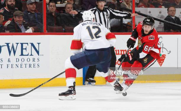 Mike Hoffman of the Ottawa Senators stickhandles the puck against Ian McCoshen of the Florida Panthers at Canadian Tire Centre on March 20 2018 in...